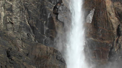 A dramatic panoramic view of a waterfall from the spray at the bottom to the top where the water cas Footage