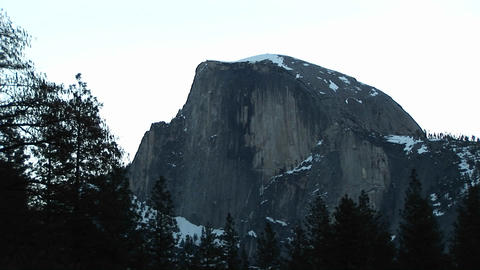 Long-shot of the barren face of Half Dome peak in Yosemite National Park Footage