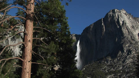 A spectacular view of a mountain waterfall in the... Stock Video Footage
