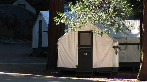 Medium-shot of park tents provided for campers at... Stock Video Footage