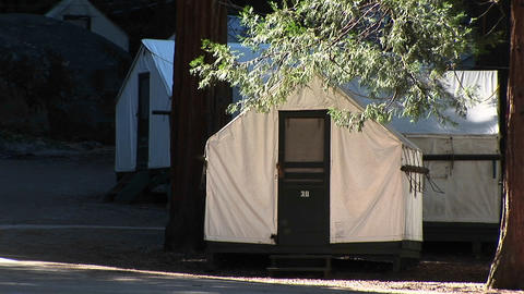Medium-shot of park tents provided for campers at Yosemite National Park Footage