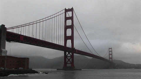 View of the Golden Gate Bridge's incredible span across San Francisco Bay on a foggy day Footage