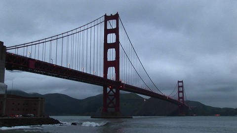 Surf rolls over rocks under historic Golden Gate Bridge in San Francisco Bay Footage