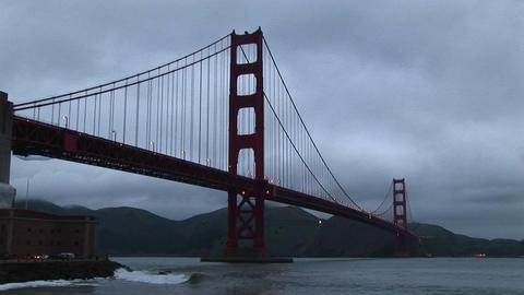 Surf rolls over rocks under historic Golden Gate Bridge... Stock Video Footage