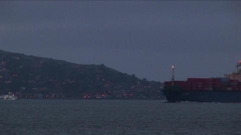 A container ship moves slowly through San Francisco Bay Stock Video Footage