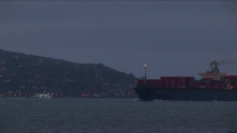 A container ship moves slowly through San Francisco Bay Stock Video Footage