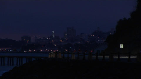 Cars head towards the Golden Gate Bridge and the temptations of San Francisco at night Footage