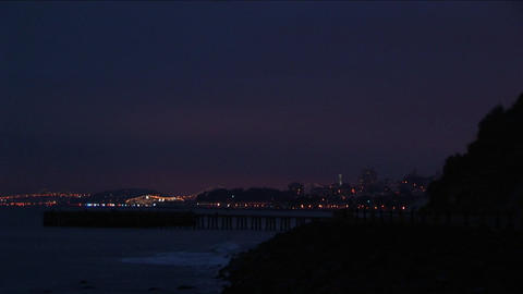 A spectacular view of the San Francisco skyline at night from across San Francisco Bay Footage