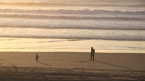 A man smokes a cigarette on a deserted beach while a... Stock Video Footage