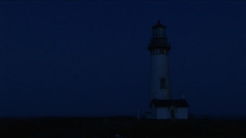 A lighthouse at night with its flashing light Stock Video Footage