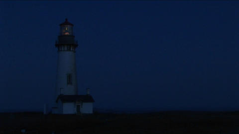 Medium shot of lighthouse at night with its bright beacon... Stock Video Footage