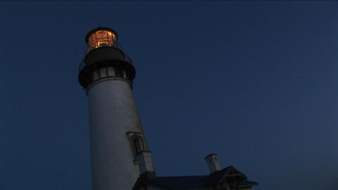 A worms-eye view of a lighthouse tower and beacon at night Stock Video Footage