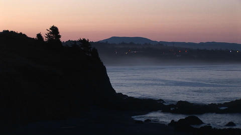 Long-shot of a steep, rocky coastline Stock Video Footage