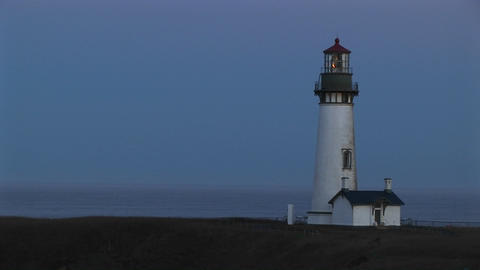 A beautiful blue sky is the perfect backdrop for this white lighthouse and the keeper's home Footage