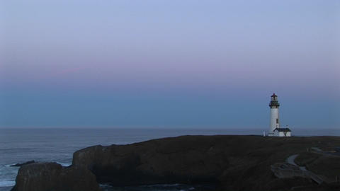 A lonely lighthouse flashes its signal at a quiet sea Stock Video Footage