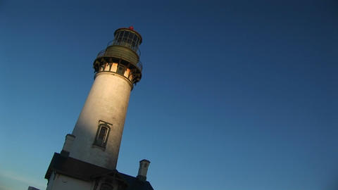A hand-held, jaunty view of a lighthouse with sunlight on... Stock Video Footage