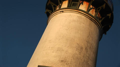 The camera slowly pans up a lighthouse for a dizzying... Stock Video Footage