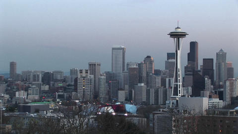 The Space Needle stands out in this aerial view of Seattle's stunning skyline during the golden hour Footage