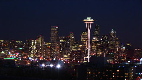 Seattle glitters at night, with the landmark Space Needle... Stock Video Footage
