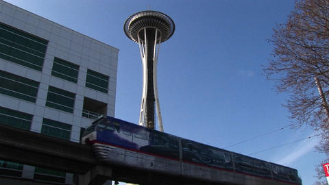 A close-up of the monorail passing by Seattle's landmark... Stock Video Footage