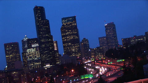 An angled view of Seattle's downtown skyline at night with traffic Footage