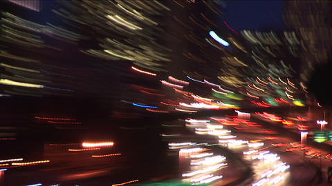 A hand-held camera zooms in and out, creating abstract, often explosive, images of Seattle at night Footage