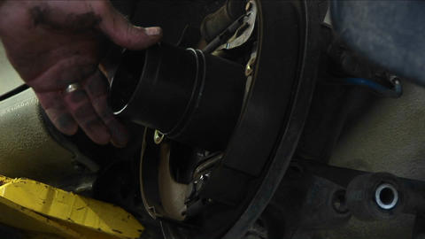 Close-up of a mechanic works on a wheel repair Stock Video Footage