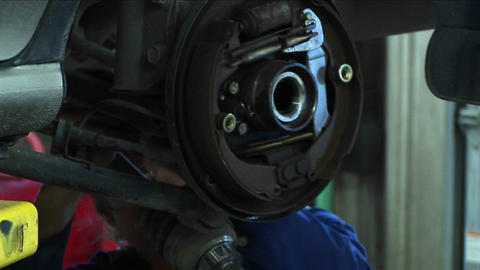 Close-up of a mechanic working on a wheel-mount repair Footage