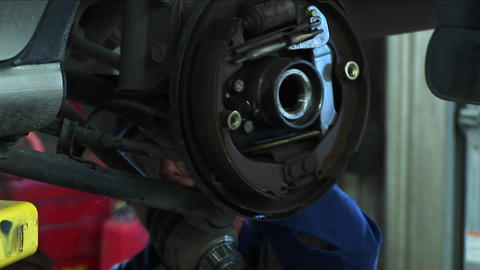 Close-up of a mechanic working on a wheel-mount repair Stock Video Footage