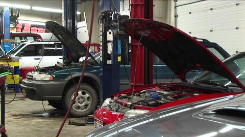 Medium-shot of cars in a repair shop Stock Video Footage