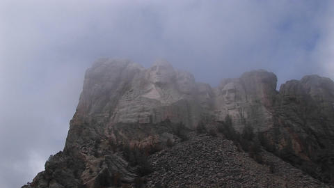 A misty view of Mt. Rushmore's world-renowned sculptures Stock Video Footage