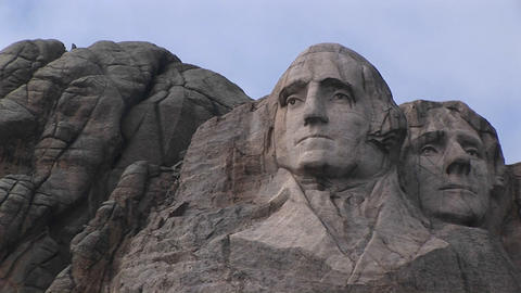 The camera focuses on the serene expression of George Washington in this close-up view of Mt. Rushmo Footage