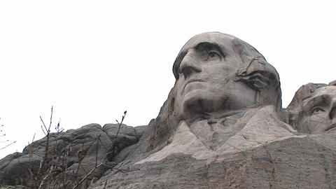 Worms-eye view of the granite face of George Washington at Mt. Rushmore Footage