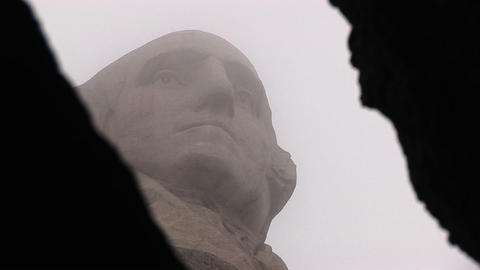 An artistic framing of George Washington by the camera at Mt. Rushmore Footage
