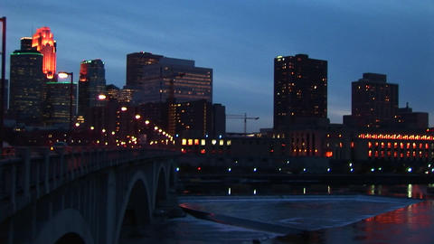 Left-pan across the Minneapolis, Minnesota skyline from the Mississippi River at night Footage