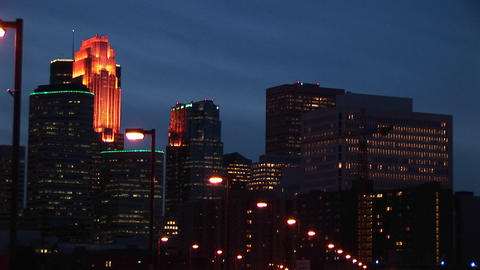 A night skyline of buildings with interior and exterior... Stock Video Footage