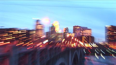 Swish-pan creating trace lights of Minneapolis Minnesota skyline at twilight Footage