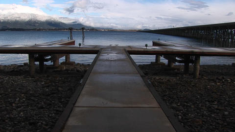 A boat-dock and fishing-pier are deserted in this winter scene Footage