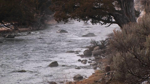 A stream flows over rocks in winter Stock Video Footage