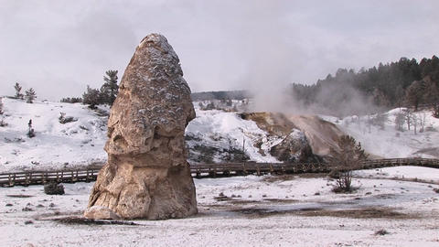 Zoom-in to close-up of a limestone-deposit cone standing tall in Yellowstone National Park Footage