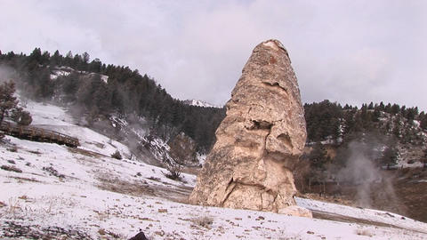 Tilt shot of a limestone cone created by mineral deposits in Yellowstone National Park Footage