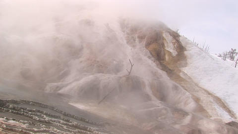 Long-shot of smoke and steam rising from a geothermal... Stock Video Footage