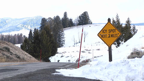 Snow poles line a rural highway in the mountains Stock Video Footage