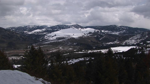 A look at the mountains in winter with billowing snow... Stock Video Footage