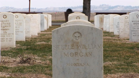 White marble headstones show men and women from all parts of the country are buried in this military Footage
