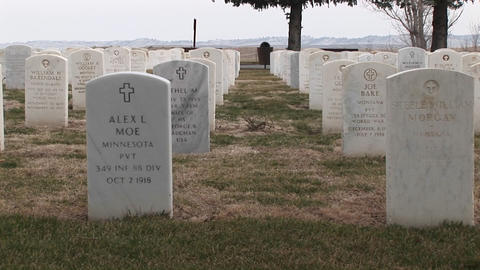 The camera pans an old military cemetery with white... Stock Video Footage