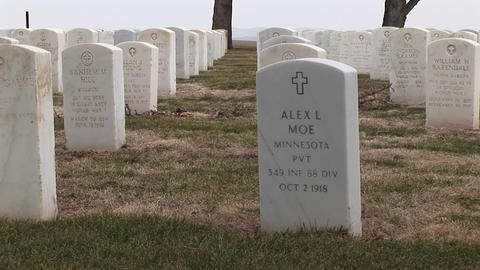 The camera pans across the rows of headstones at... Stock Video Footage
