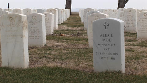 The camera pans across the rows of headstones at Arlington National Cemetery Footage