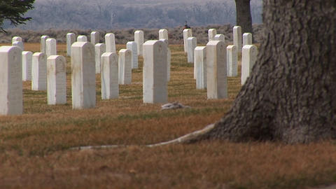 A low-angle shot of white marble headstones in Arlington National Cemetery Footage