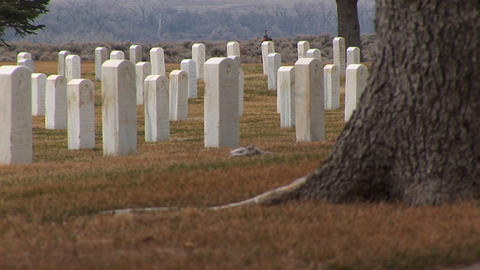 A low-angle shot of white marble headstones in Arlington... Stock Video Footage